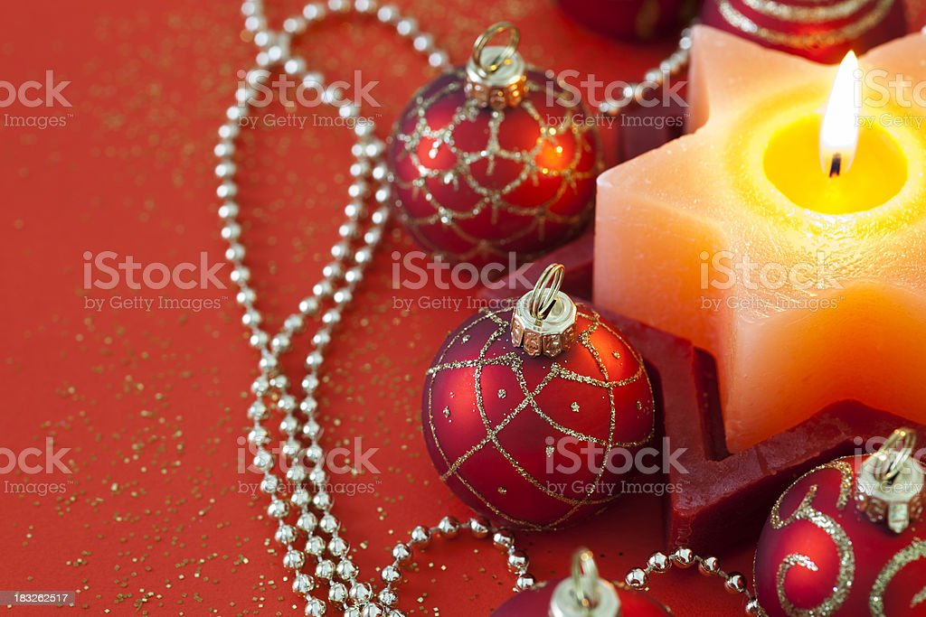 Christmas Candle & Red Baubles royalty-free stock photo
