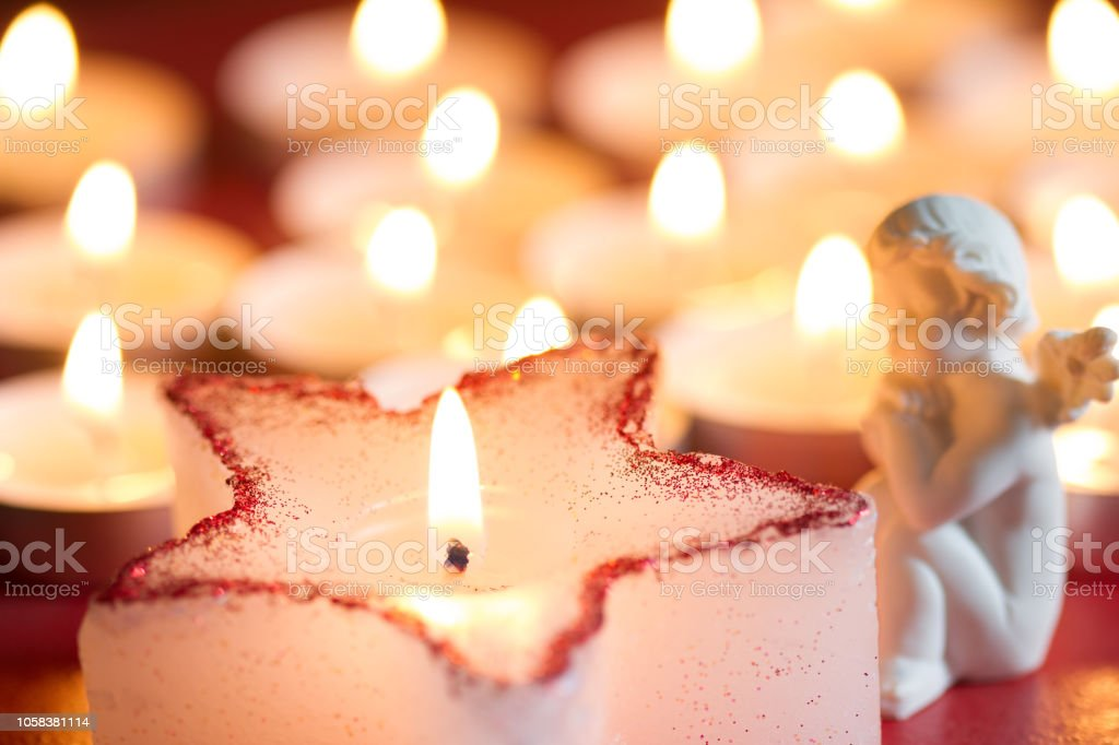 Christmas candle star and angel abstract background in night stock photo