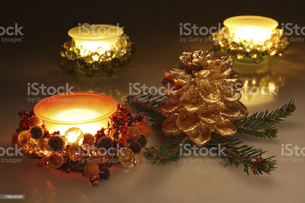Christmas candles and golden pine cone royalty-free stock photo