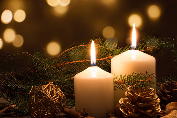 Christmas candles and lights stock photo