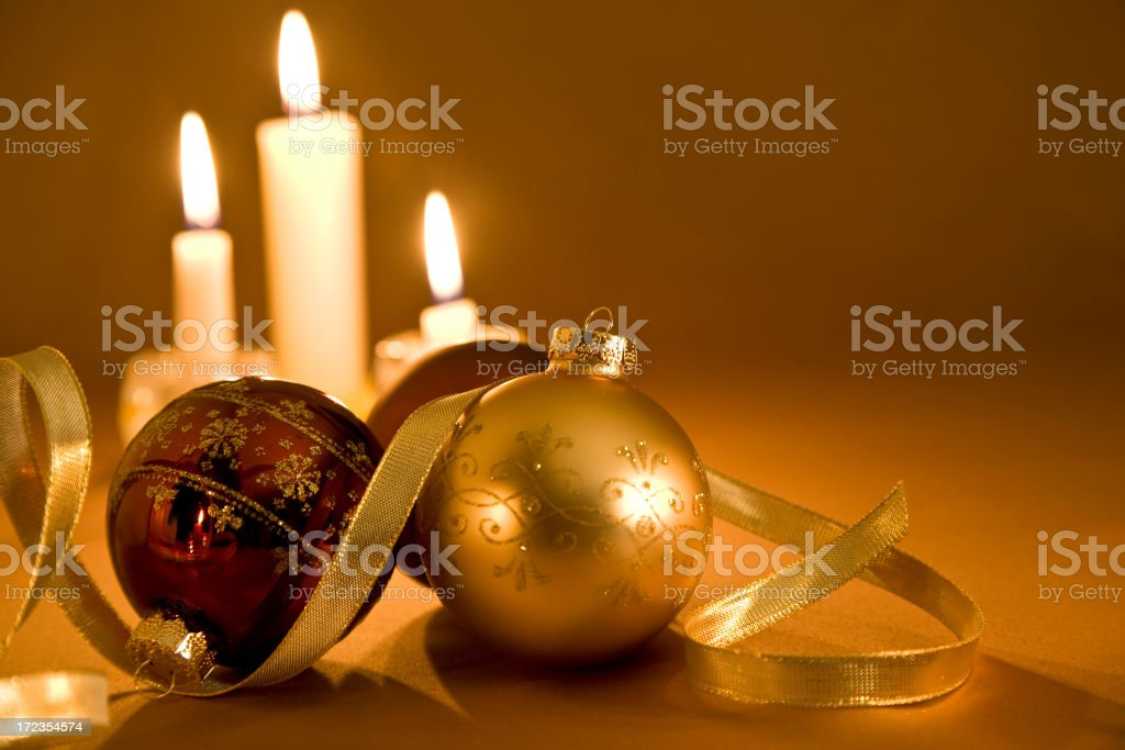 Christmas Candles & Baubles on a Golden Background royalty-free stock photo