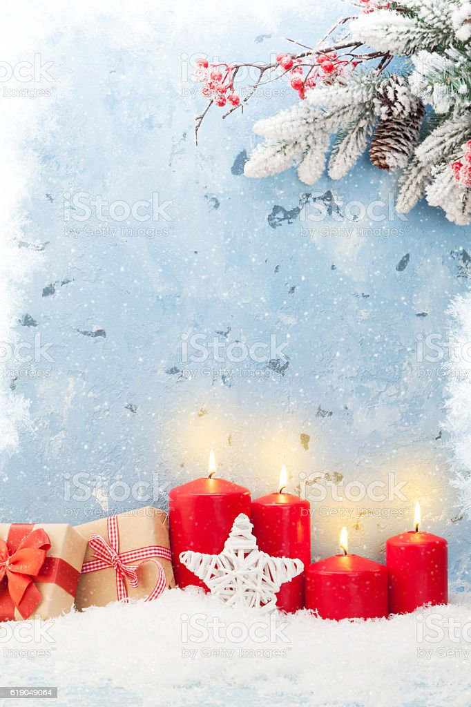 Christmas candles, gifts and fir tree stock photo