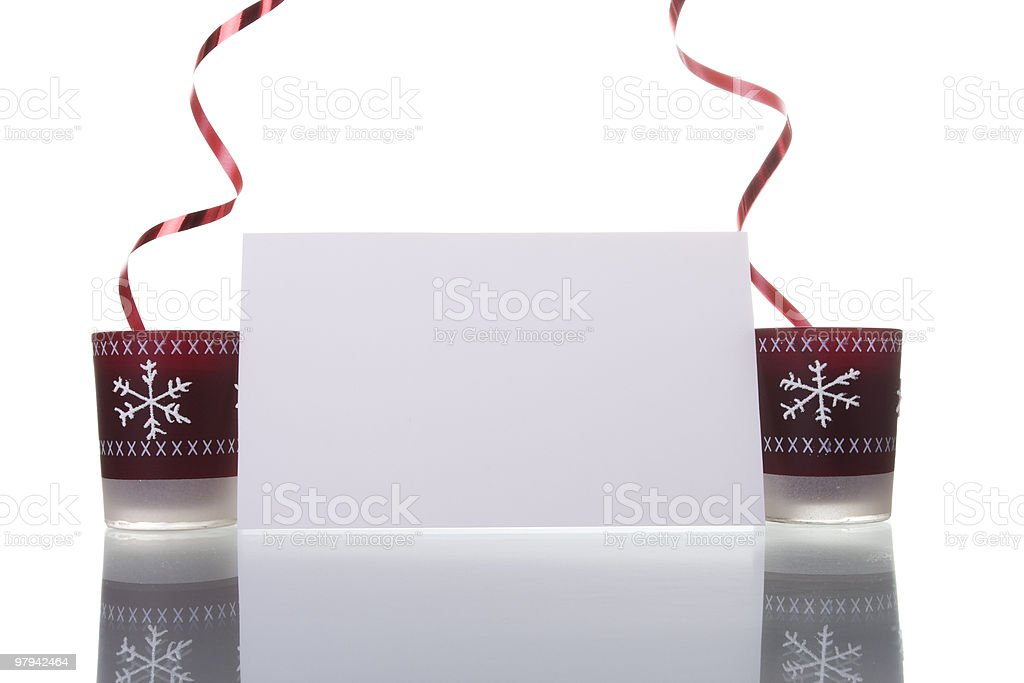christmas candles holding a blank card royalty-free stock photo