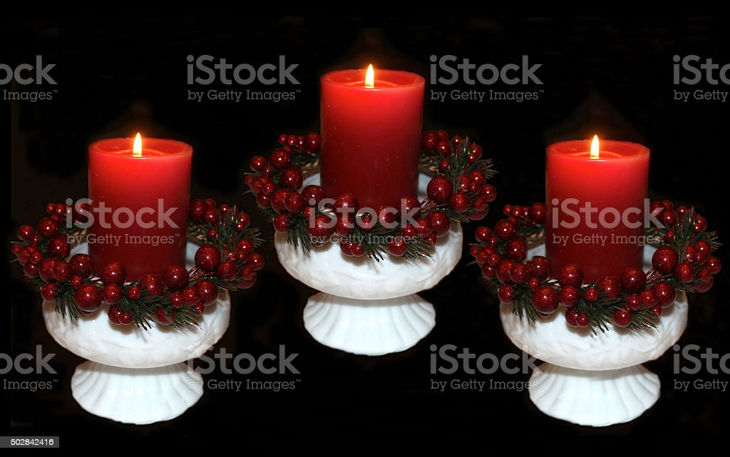 Christmas Candles in White Fenton and Milk Glass Candleholders stock photo
