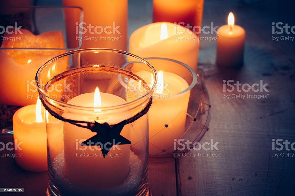 Christmas candles on a white wooden background stock photo