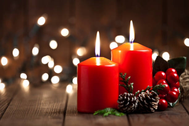 Christmas candles on rustic wooden table stock photo