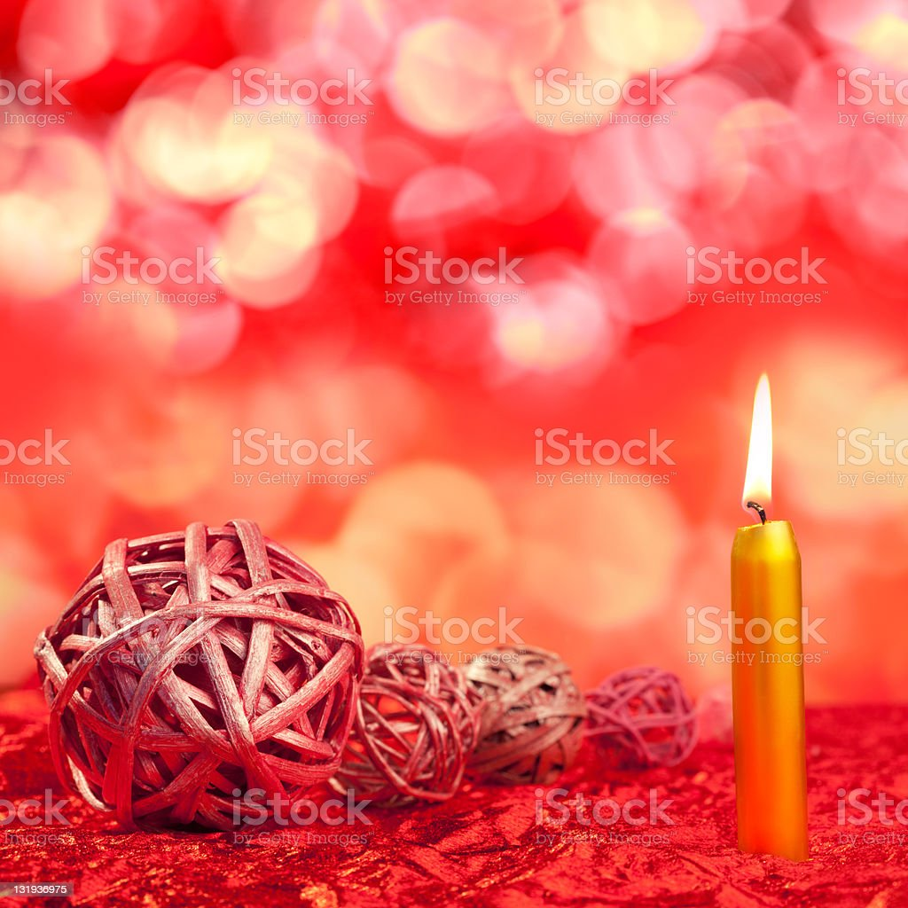 christmas candles with dried baubles on red royalty-free stock photo