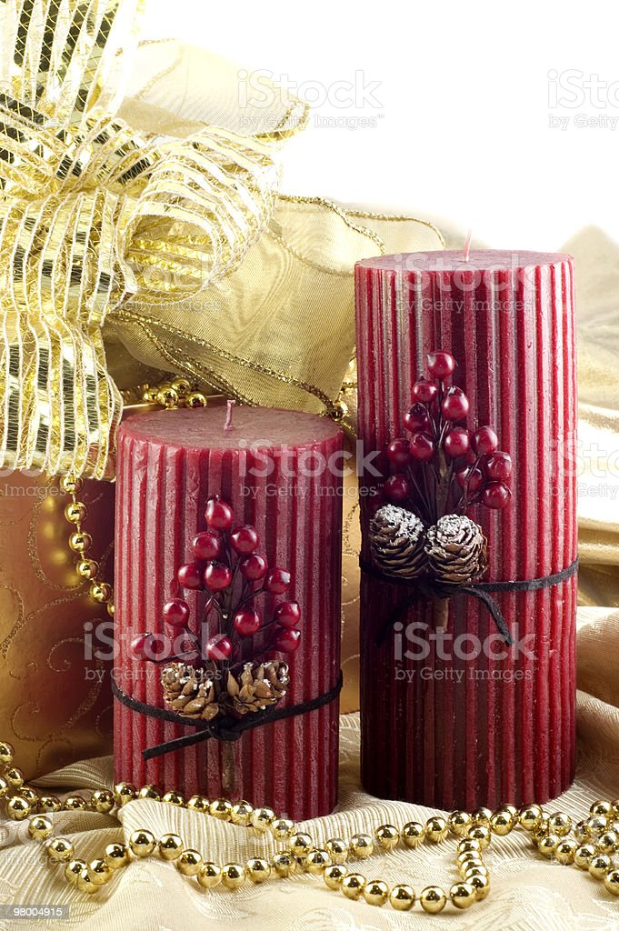 Christmas Candles with Gold Decorations royalty-free stock photo