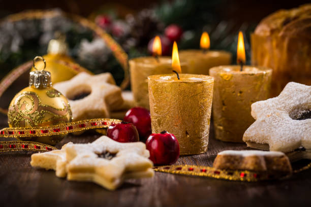 Christmas candles with homemade cookies in star shape stock photo