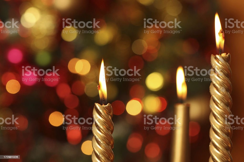 Christmas Candles with Lights and Tree in Background stock photo