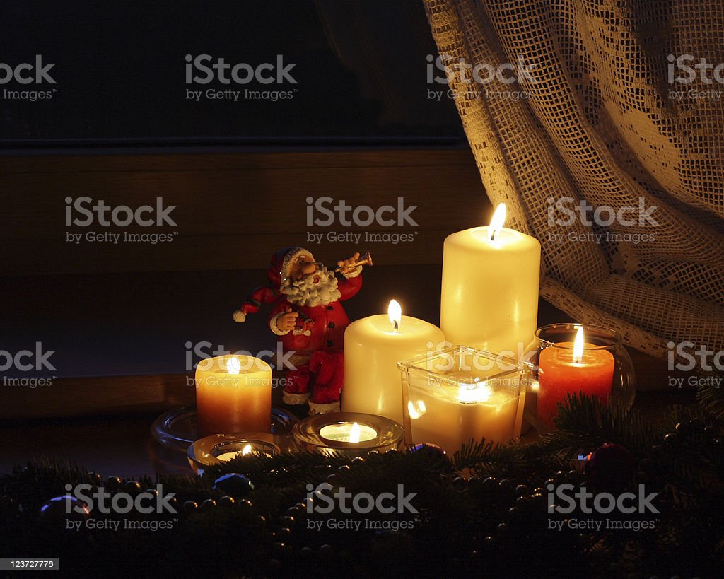 Christmas candles with Santa Claus royalty-free stock photo