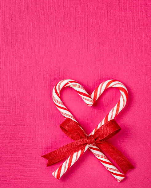 Christmas Candy Cane Heart on a Pink background stock photo