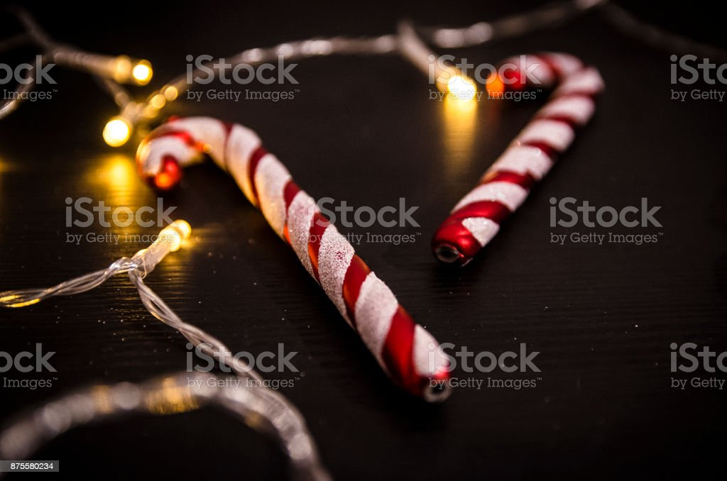 Christmas candy cane surrounded by lights stock photo