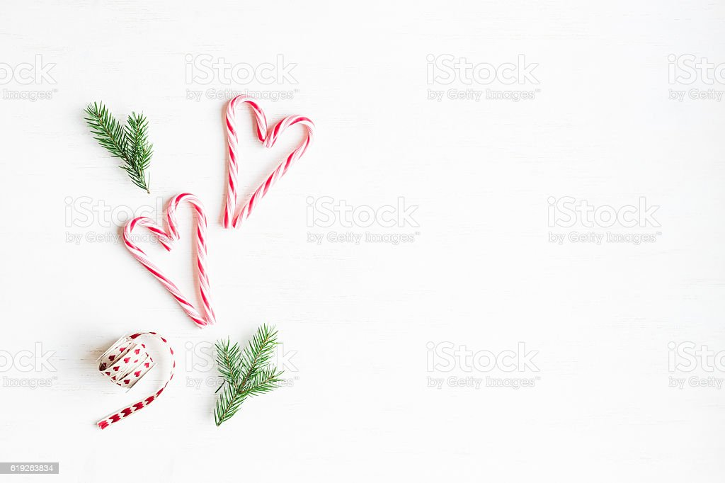 Christmas candy canes and fir branches. Flat lay, top view stock photo