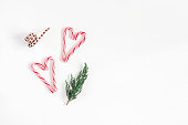 istock Christmas candy canes and fir branches. Flat lay, top view 865090936