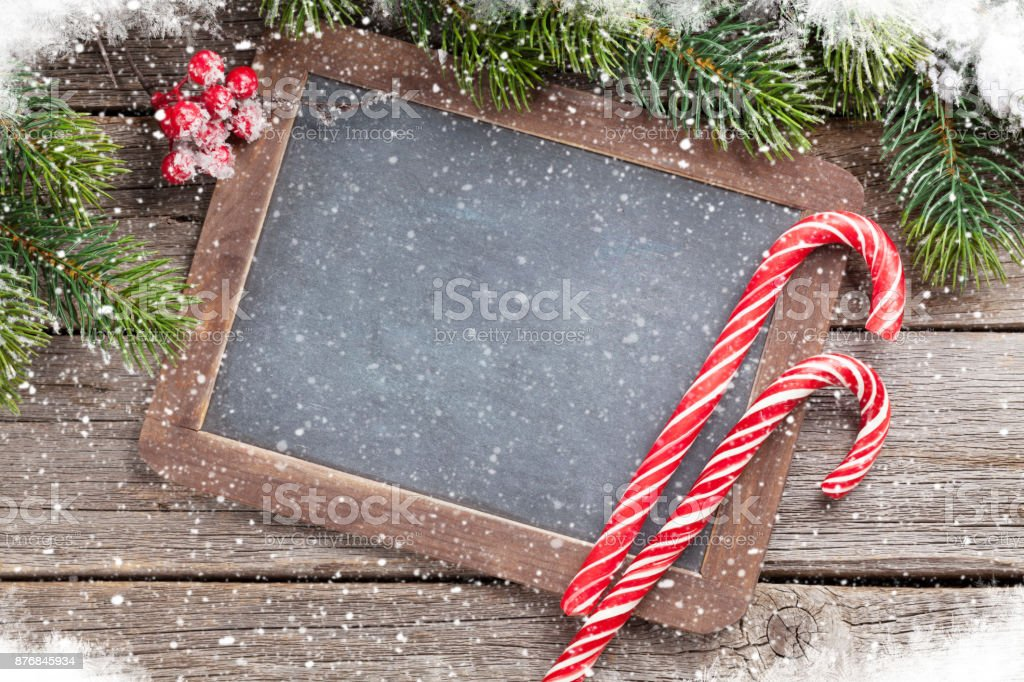Christmas candy canes and fir tree stock photo