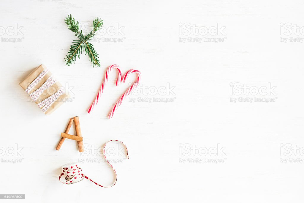 Christmas candy canes, gift, cinnamon sticks and fir branches stock photo