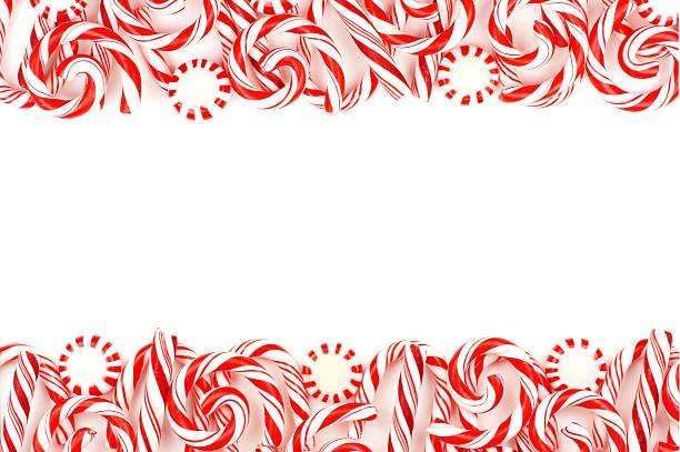 Christmas candy double border over white Christmas candy double border with peppermints and candy canes over a white background candy cane stock pictures, royalty-free photos & images