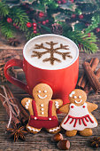 Christmas cappuccino and gingerbread cookies in front Christmas tree. The cookies are homemade made by me and are unique and can not be found anywhere.