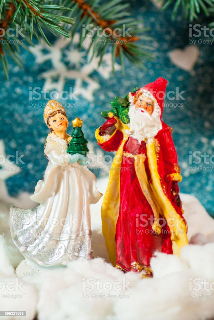 Christmas card background Santa Claus and Snow Maiden Russian Christmas characters: Snegurochka Snow Maiden with gifts bag stock photo