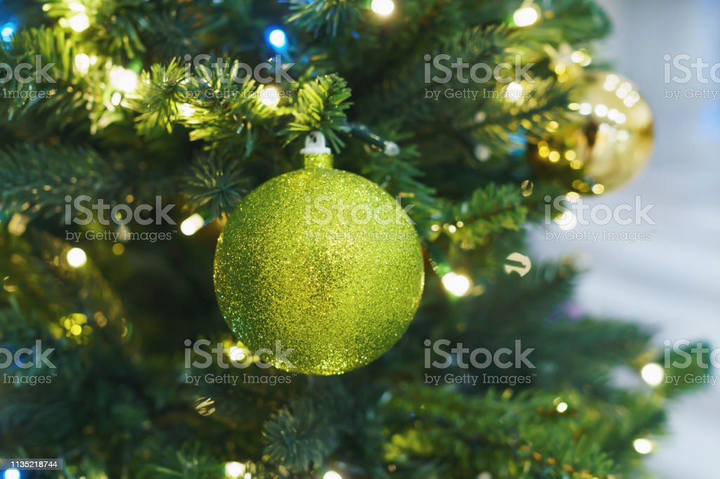 Christmas card. Christmas picture. A bright sparkling green ball on...