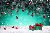 istock Christmas card - gifts and toys in the snow under the New Year tree 1182309110