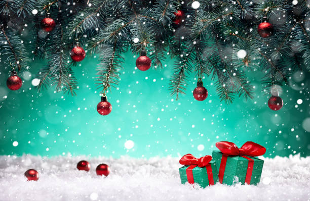 Christmas card - gifts and toys in the snow under the New Year tree stock photo