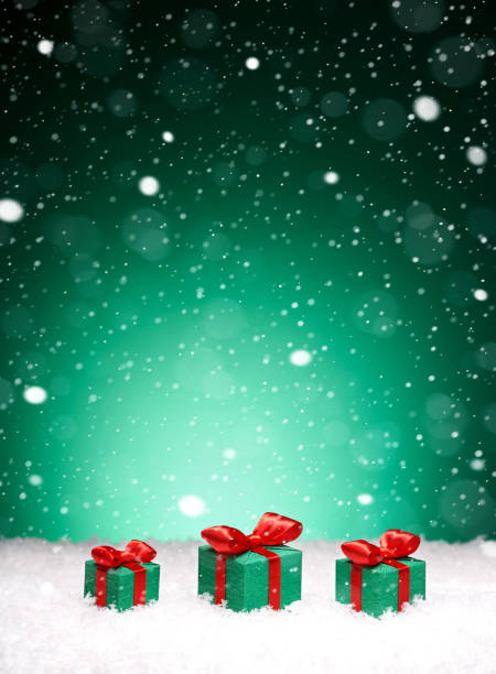 Christmas card - gifts with bows in the snow stock photo