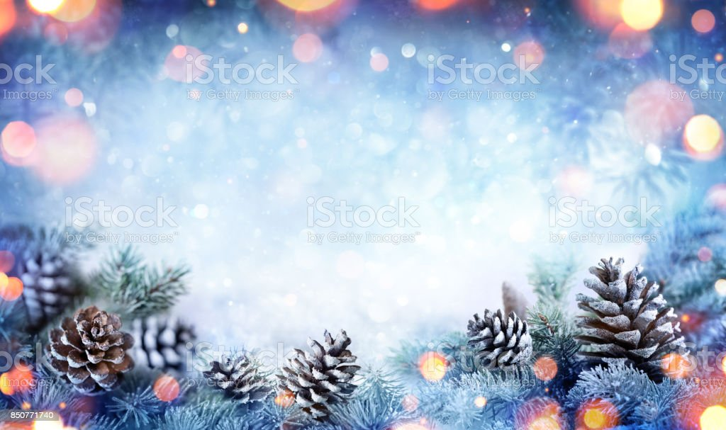Christmas Card - Snowy Fir Branch With Pine Cones And Lights stock photo
