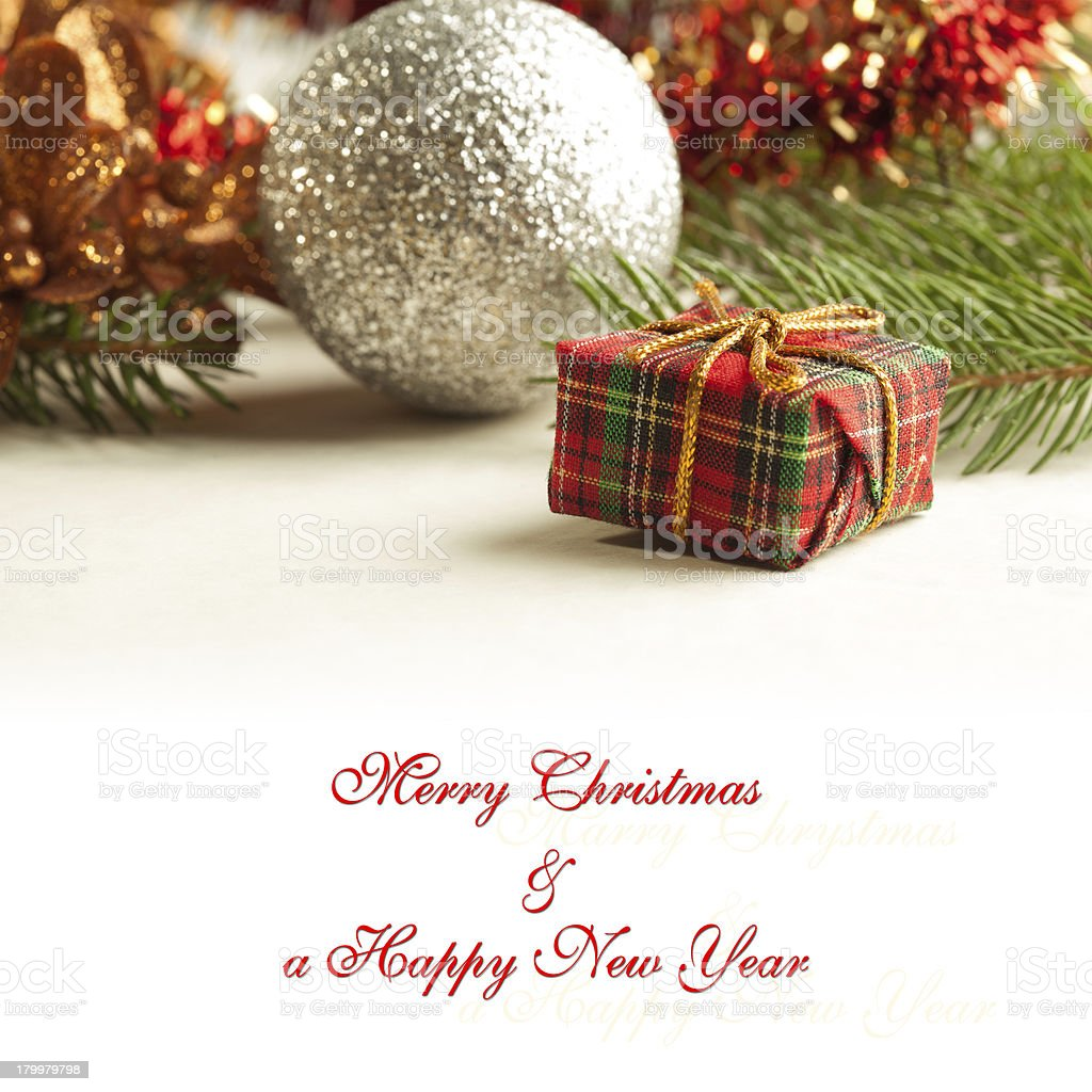 Christmas card with a gifts box and decorations royalty-free stock photo