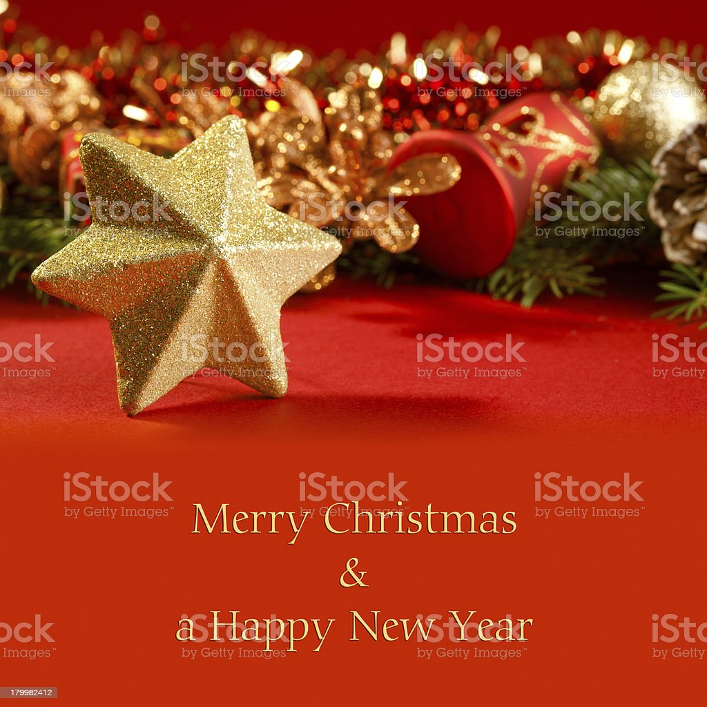 Christmas card with a star and decorations royalty-free stock photo