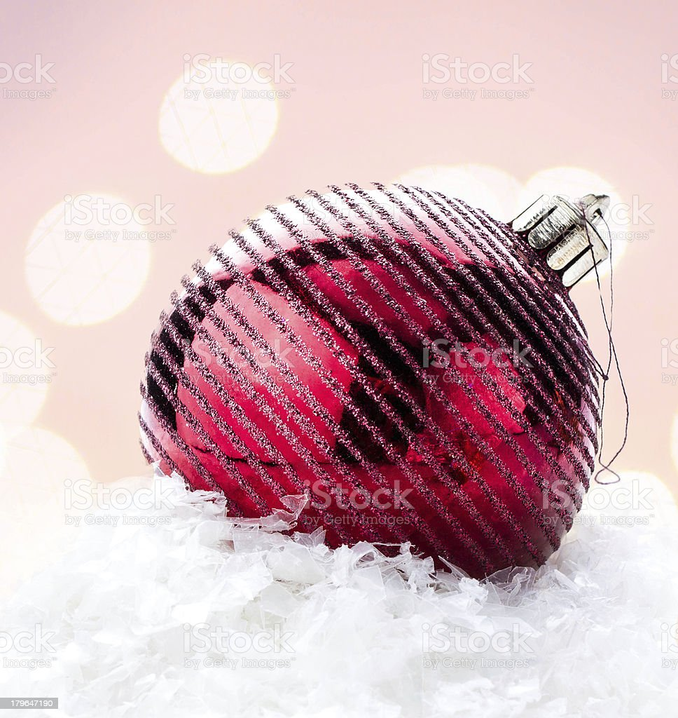 Christmas card with big red ball   and decorations on Defocused royalty-free stock photo