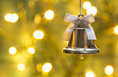 Christmas card with christmas bell and golden lights.