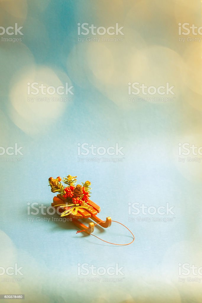 Christmas card with decorative sled standing on blue background. foto de stock royalty-free