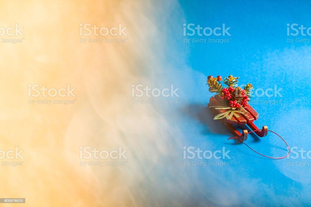 Christmas card with decorative sled standing on blue background. zbiór zdjęć royalty-free
