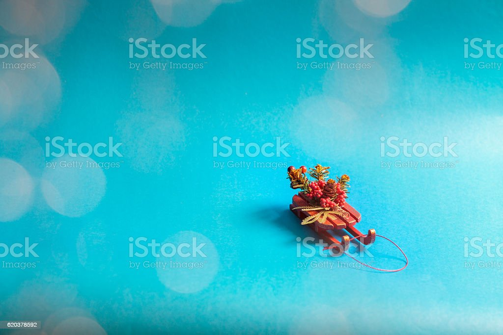 Christmas card with decorative sled standing on blue background. zbiór zdjęć royalty-free