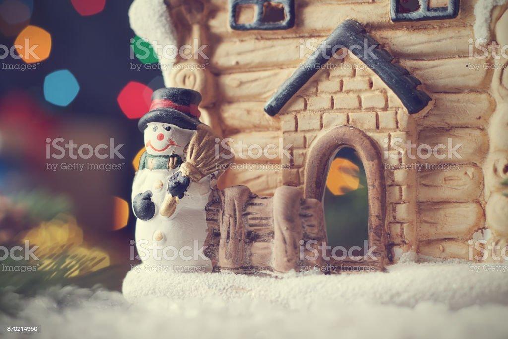 Christmas card with fairy house and snowman, magic holiday...
