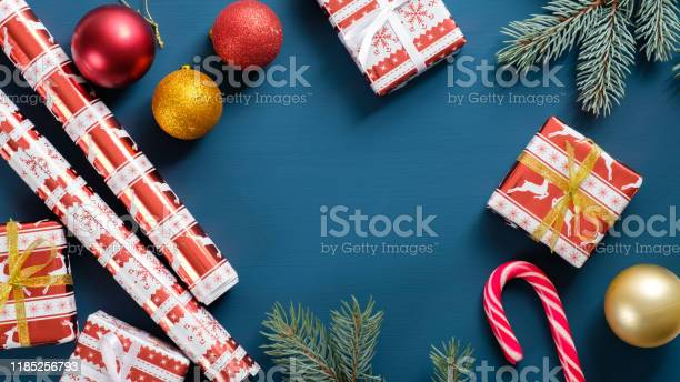 Christmas card with festive decorations on blue flat lay gift boxes picture id1185256793?b=1&k=6&m=1185256793&s=612x612&h= tb2pym4fwcfedlxkzkoan3kxhxbmxipuu5ldyhoetg=