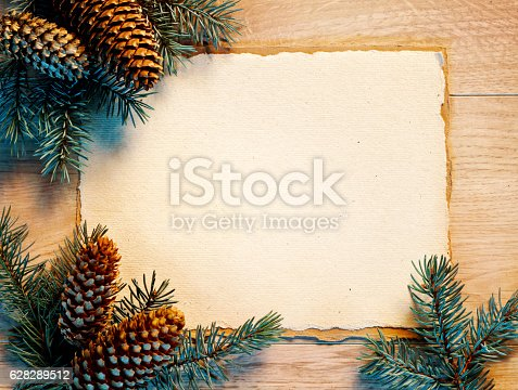 istock Christmas card with fir branches, pinecones 628289512