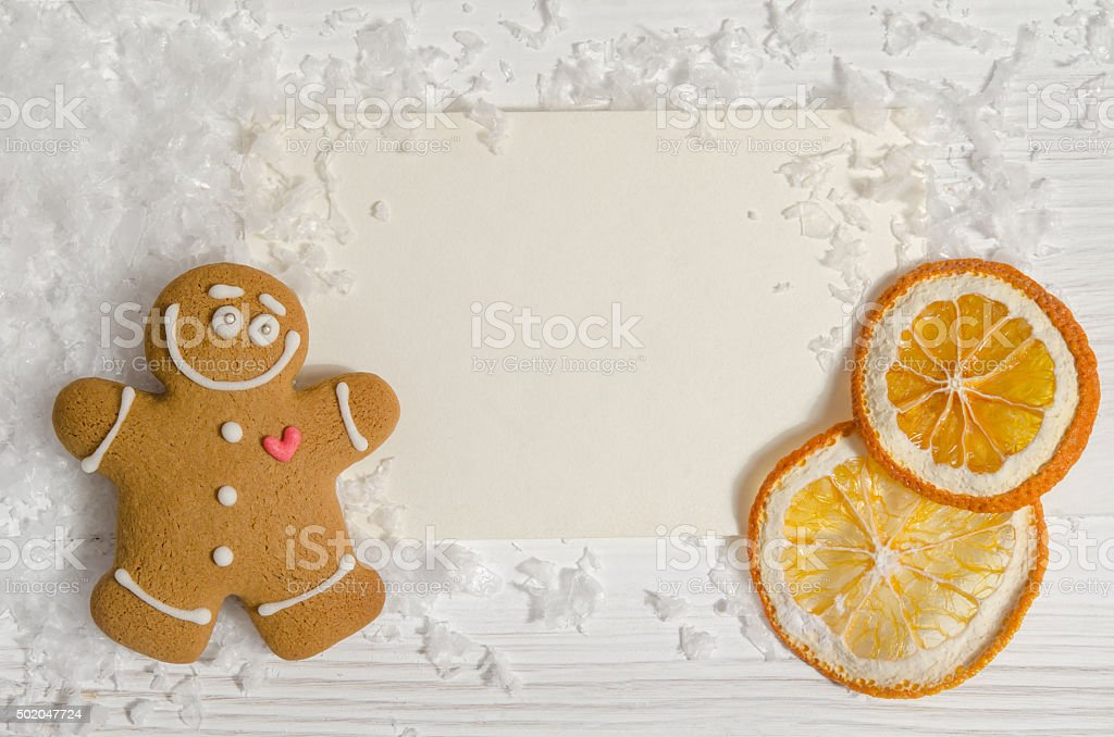 Cartolina di Natale con pan di zenzero e arancio secca - foto stock