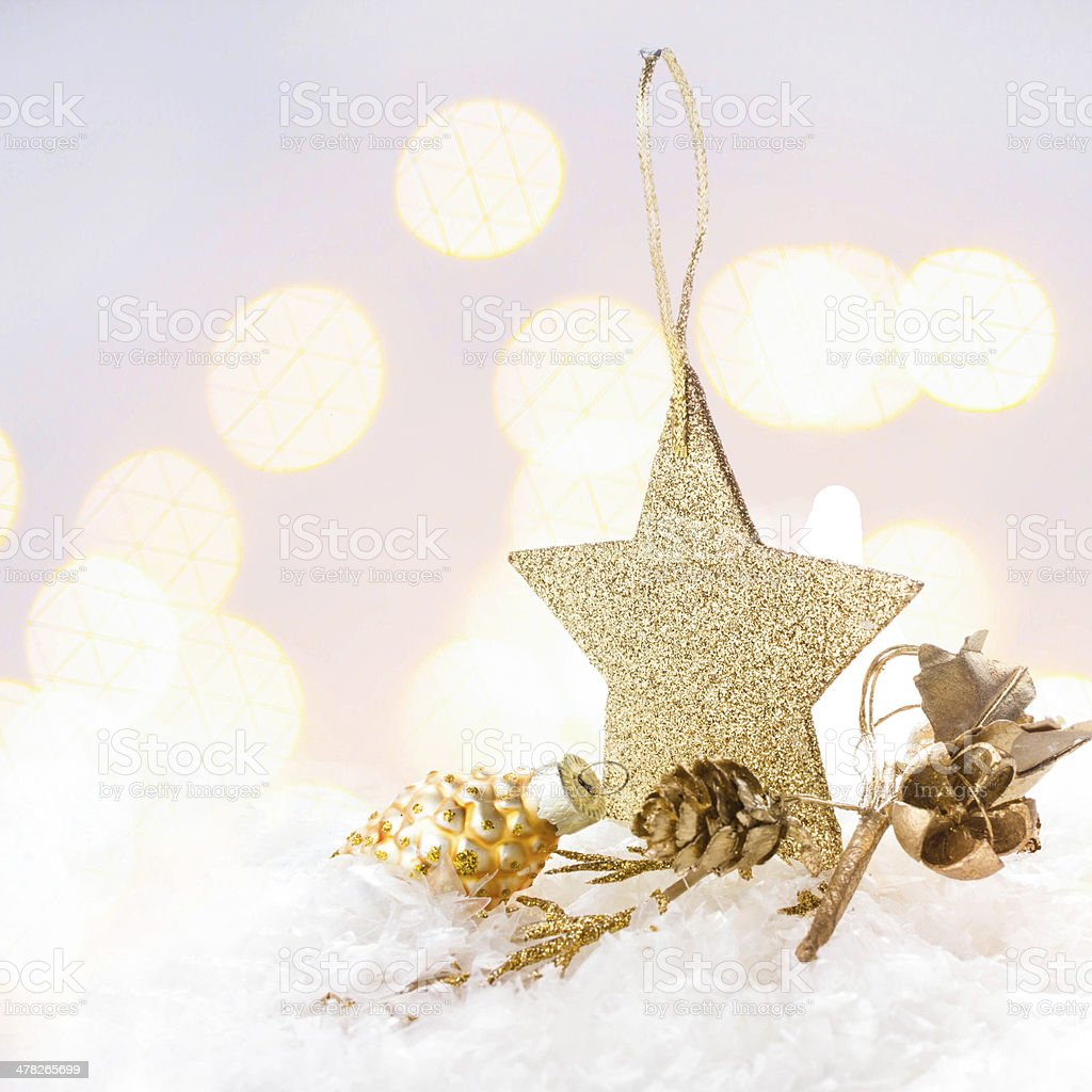 Christmas card with golden star and decorations on Defocused royalty-free stock photo