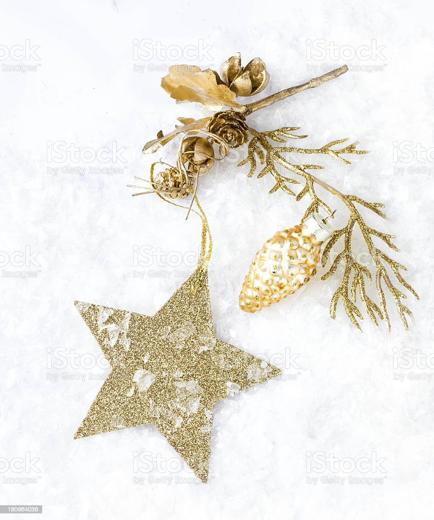 Christmas card with golden star and decorations on snow   lights royalty-free stock photo
