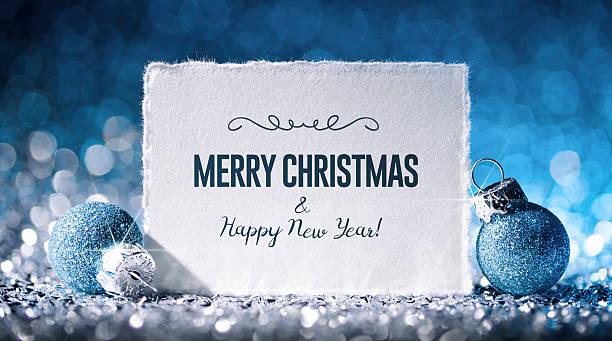 christmas card with star and ornament on glitter - paper - weihnachtskarte stock-fotos und bilder