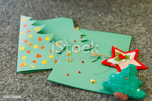 istock Christmas cards with your own hands 1034232806