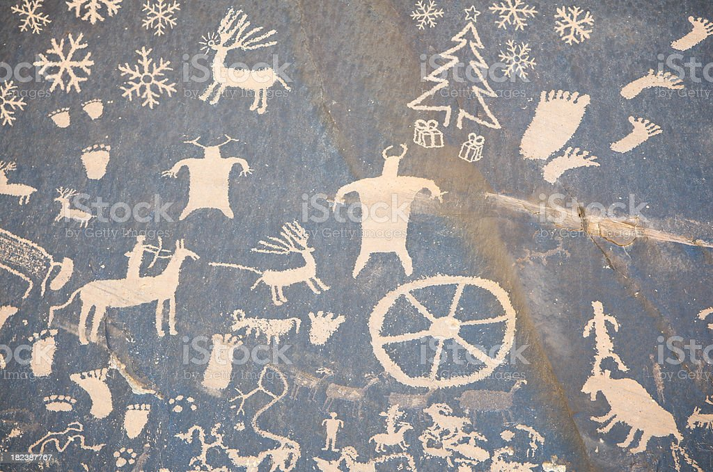Christmas Cave Drawing w Reindeer and Snowflakes stock photo