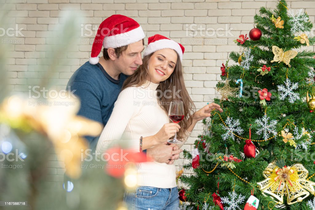 Christmas Celebration Of Couples Stock Photo Download Image Now Istock