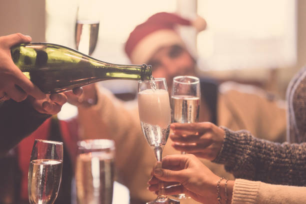 Christmas celebration with champagne - group of friends drinking and toasting together