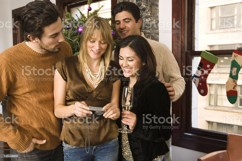 christmas celebration with friends and camera royalty-free stock photo