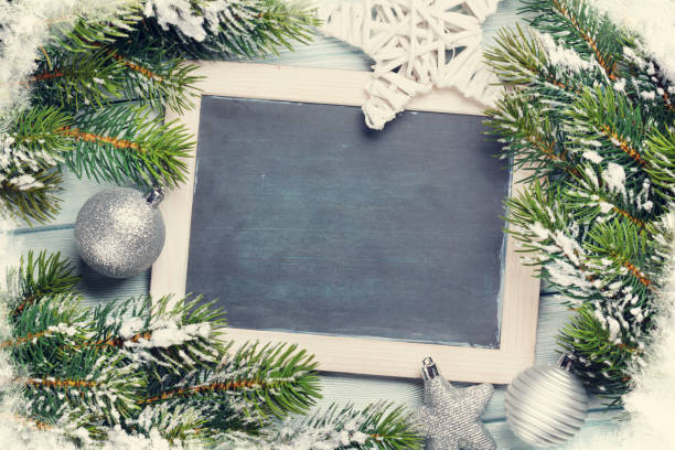 Christmas chalkboard, decor and fir tree stock photo
