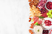 istock Christmas charcuterie side border against a white marble background 1282334016
